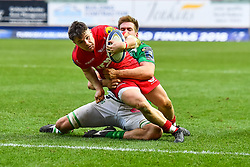 Scarlets' Steff Evans is tackled by Benetton Treviso's Sebastian Negri<br /> <br /> Photographer Simon King/Replay Images<br /> <br /> EPCR Champions Cup Round 3 - Scarlets v Benetton Rugby - Saturday 9th December 2017 - Parc y Scarlets - Llanelli<br /> <br /> World Copyright © 2017 Replay Images. All rights reserved. info@replayimages.co.uk - www.replayimages.co.uk