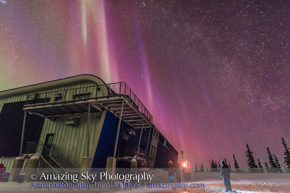 """Volunteer Brian Friedmann takes lit """"selfie"""" portait images of people under the Northern Lights at the Churchill Northern Studies Centre, Churchill, Manitoba."""