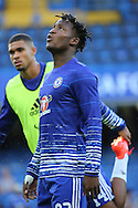Chelsea striker Michy Batshuayi (23) looking up to sky whilst warming up during the EFL Cup match between Chelsea and Bristol Rovers at Stamford Bridge, London, England on 23 August 2016. Photo by Matthew Redman.