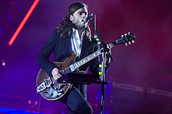 © Licensed to London News Pictures. 28/08/2015. Reading Festival, UK.  Mumford and Sons performing at Reading Festival 2015 28 August 2015 Day 1.  In this picture - Winston Marshall.  Photo credit: Richard Isaac/LNP