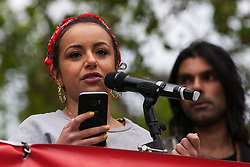 London, UK. 1st May, 2019. Dalia Gebrial, editor at Novara Media, addresses climate protesters at a Declare A Climate Emergency Now demonstration in Parliament Square organised to coincide with a motion in the House of Commons to declare an environment and climate emergency tabled by Leader of the Opposition Jeremy Corbyn. The motion, which does not legally compel the Government to act, was passed without a vote.