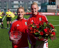 YSTRAD MYNACH, WALES - Wednesday, April 5, 2017: Wales' Jessica Fishlock (left) receives flowers to mark her 100th cap from Sophie Ingle ahead of the Women's International Friendly match against Northern Ireland at Ystrad Mynach.(Pic by Laura Malkin/Propaganda)