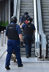 Armed police on an escalator at the foot of the Shard outside London Bridge station, near the scene of last night's terrorist incident.