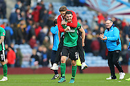 Luke Waterfall of Lincoln City celebrates after the final whistle. The Emirates FA cup 5th round match, Burnley v Lincoln City at Turf Moor in Burnley, Lancs on Saturday 18th February 2017.<br /> pic by Chris Stading, Andrew Orchard Sports Photography.