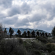 MANTAMADOS, GREECE - FEBRUARY 26: Mantamados villagers clash with Greek police force known as the MAT in protest of a new proposed migrant detention camp in Mantamados on the Greek Island of Lesvos on Wednesday, February 26, 2020. The neighboring island of Chios also held demonstrations for its planned detention center. (Photo by Byron Smith/Getty Images)