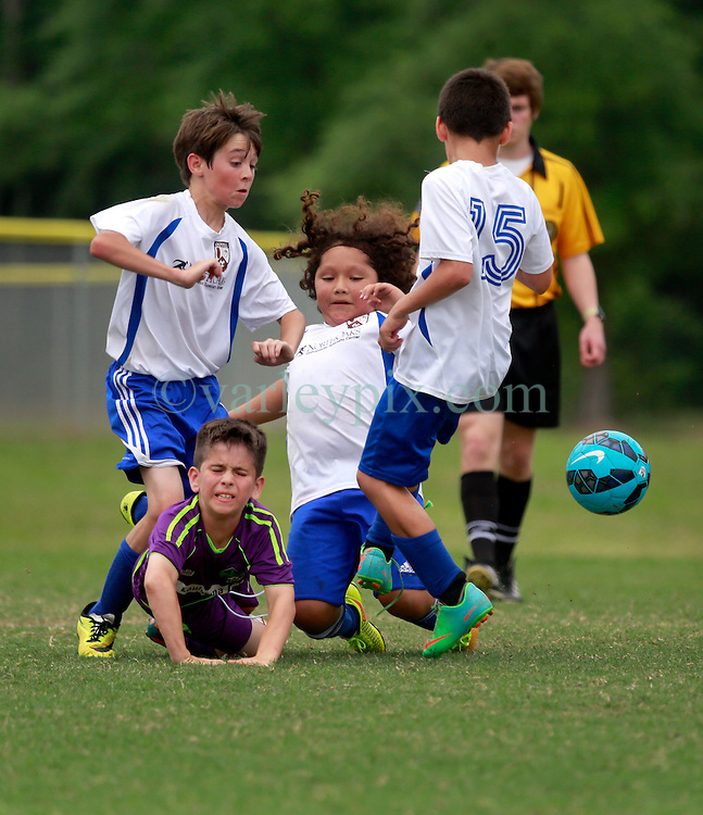 11 April 2015. Hammond, Louisiana.<br /> U10 New Orleans Jesters Elites, team purple play STYSA Tigers at the Strawberry Cup hosted by the South Tangipahoa Youth Soccer Association (STYSA). Jesters emerged victorious with a 13-0 win.<br /> Photo; Charlie Varley/varleypix.com
