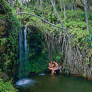 people, waterfall, Kauai, Hawaii, USA<br />