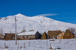Hay Piled High Next to Homes, Syunik Province