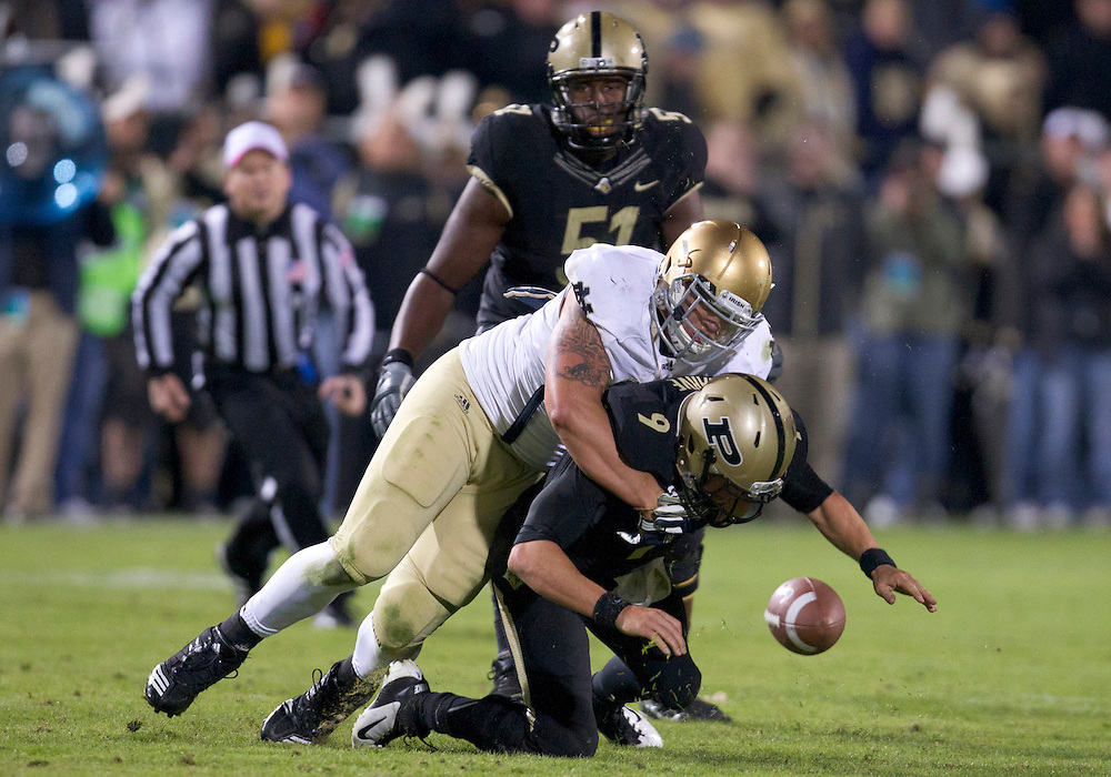 October 01, 2011:  Notre Dame defensive end Aaron Lynch (#19) sacks Purdue quarterback Robert Marve (#9) during NCAA Football game action between the Notre Dame Fighting Irish and the Purdue Boilermakers at Ross-Ade Stadium in West Lafayette, Indiana.  Notre Dame defeated Purdue 38-10.