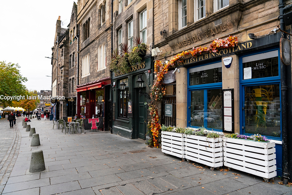 Edinburgh, Scotland, UK. 17 October 2020. Saturday afternoon in Edinburgh city centre during 16 day short circuit lockdown and bars are closed but cafes remain open. Streets in the Old town are very quiet and reminiscent of the eerie emptiness seen during the full lockdown earlier this year.  Row of closed bars on the Grassmarket. Iain Masterton/Alamy Live News