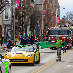 York, PA - March 12, 2016: Like most parades, fire engines with local firefighters are at the annual Saint Patrick's Day Parade in the downtown City of York, Pennsylvania.