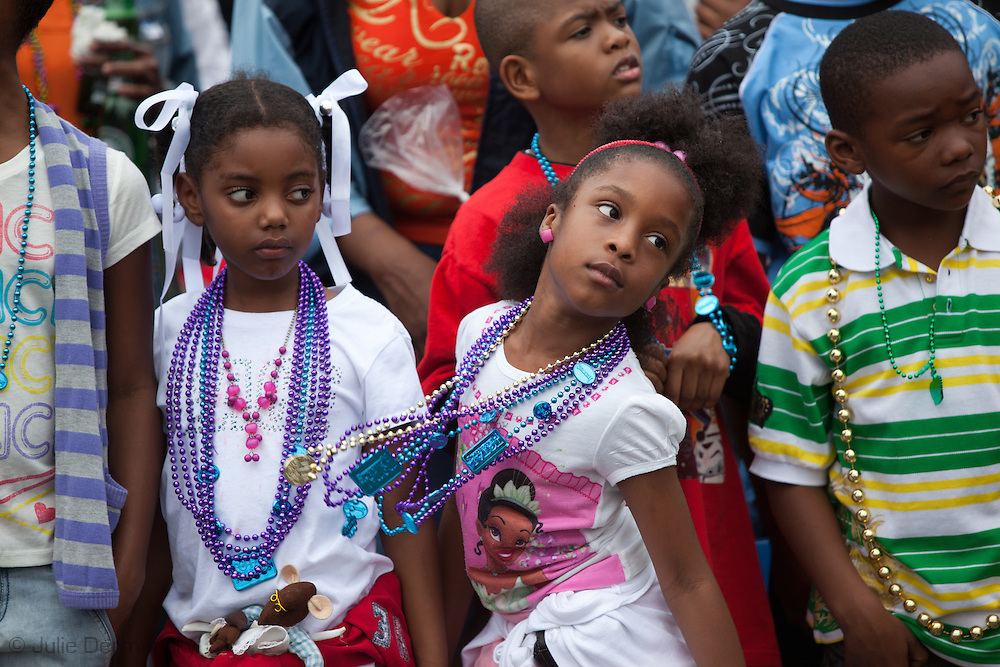 Girls with Mardi Gras Beads along the Zulu Parade route on Fat Tuesday, Mardi Gras Day. Mardi Gras 2011 in New Orleans is expected to be have the largest attendance of all time due to the dates overlapping with college spring break. Mardi Gras also known as Carnival begins on or after Epiphany and ending on the day before Ash Wednesday.