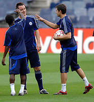 Photo: Richard Lane.<br />Chelsea training session. UEFA Champions League. 30/10/2006. <br />Chelsea captain John Terry has his ears flicked by Shaun Wright-Phillips and Carlo Cudicini during a training ground game.