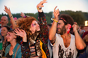 Fans of the band The Correspondants, dancing in the Shangri La field, Glastonbury Festival 2016. The Glastonbury Festival is the largest greenfield festival in the world, and is now attended by around 175,000 people. Its a five-day music festival that takes place near Pilton, Somerset, United Kingdom. In addition to contemporary music, the festival hosts dance, comedy, theatre, circus, cabaret, and other arts. Held at Worthy Farm in Pilton, leading pop and rock artists have headlined, alongside thousands of others appearing on smaller stages and performance areas.