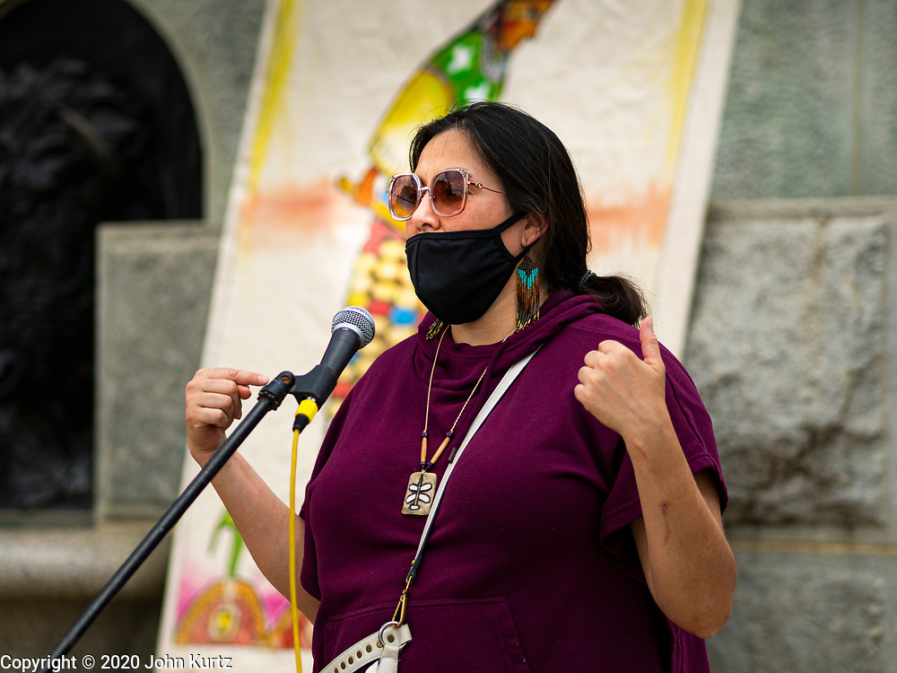 04 JULY 2020 - DES MOINES, IOWA: CHRISTINE NOBISS, of Seeding Sovereignty, talks about the stereotypical depiction of Native Americans in artwork in the Iowa State Capitol. Hundreds of people came to the grounds of the Iowa State Capitol to protest against and in favor of historic monuments on the capitol grounds. Several hundred people protested against a monument to Christopher Columbus and the stereotypical depiction of Native Americans on the capitol grounds. About 50 people came to the capitol to rally in support of the monuments. The protest against the monuments was organized by Seeding Sovereignty, a collective of indigenous women. The rally to defend the monuments was organized by an Iowa chapter of Three Percenters.     PHOTO BY JACK KURTZ