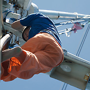 Seaman climbing the mast.