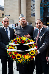 Members of the Sheffield Federation of Mosques laid a wreath in memory of Lee Rigby the soldier murdered outside Woolwich Barracks. left to right Labor Cabinet Member Cllr Mazhar Iqbal, Imam Mohammad Ismail and Mohammad Ali from the Pakistani Muslim Centre place the wreath on the Sheffield War memorial in Barkers Pool on Friday Evening (May 31) . Saturday Lunch Time June 1) The EDL will be holding a ceremony to place their own Wreath in Barkers Pool