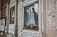 Outside the front entrance to the Melkite Greek Catholic Patriarchal Cathedral in Damascus, Syria, religious art shows the Virgin Mary looks at Jesus hanging from the cross. In 2010, of the 23 million people in Syria, approximately 8 to 10 percent were Christian.<br /><br />(June 6, 2010)