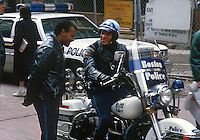 Massachusetts, USA, policemen, one on a motorbike and the other driving a patrol car, meet up on duty in Downtown Boston.  19880507BPM..Copyright Image from Victor Patterson, 54 Dorchester Park, Belfast, UK, BT9 6RJ..Tel: +44 28 9066 1296.Mob: +44 7802 353836.Voicemail +44 20 8816 7153.Skype: victorpattersonbelfast.Email: victorpatterson@me.com.Email: victorpatterson@ireland.com (back-up)..IMPORTANT: If you wish to use this image or any other of my images please go to www.victorpatterson.com and click on the Terms & Conditions. Then contact me by email or phone with the reference number(s) of the image(s) concerned.