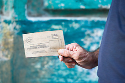 November 27, 2016 - Havana, Cuba - A man holds the food ticket, a scene from a daily life in Havana on November 26, 2016, the next day after Fidel Castro, Cuba's historic revolutionary leader, and the former Prime Minister and President of Cuba, dies on the late night of November 25, 2016, at age of 90. . Fidel Castro died aged 90. One of the world's longest-serving rulers and modern history's most singular characters, Castro defied 11 US administrations and hundreds of assassination attempts..On Saturday, 25 November 2016, in Havana, Cuba. (Credit Image: © Artur Widak/NurPhoto via ZUMA Press)