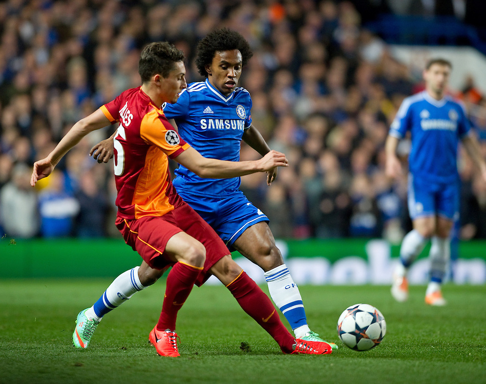 Galatasaray's Alex Telles shields the ball from Chelsea's Willian<br /> <br /> Photo by Ashley Western/CameraSport<br /> <br /> Football - UEFA Champions League First Knockout Round 2nd Leg - Chelsea v Galatasaray - Tuesday 18th March 2014 - Stamford Bridge - London<br />  <br /> © CameraSport - 43 Linden Ave. Countesthorpe. Leicester. England. LE8 5PG - Tel: +44 (0) 116 277 4147 - admin@camerasport.com - www.camerasport.com