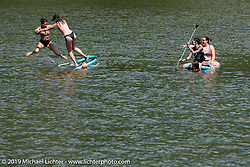Victoria Joy and Audrey Wood paddle on a reservoir during the Run to Raton. Raton, NM. USA. Saturday July 21, 2018. Photography ©2018 Michael Lichter.