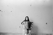 A girl practices her accordian in the ruins of the Blind School. The Blind School Sarajevo, is the only centre in Bosnia for children and young adults. It was extensively damaged during the civil war an was used by the Bosnian Serb army as a military position from which to snipe and shell the city. The few teaching staff left during the war managed to visit some of their blind pupils and continue a limited education. The school reopened after the war ended but conditions remain dire.