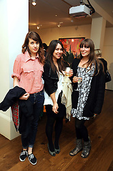 Left to right, STORM LONSDALE, ULA McCARTHY and FREYA LANGTON at an exhibition of Tahnee Lonsdale's paintings held at The Commander, 47 Hereford Road, London on 8th October 2008.