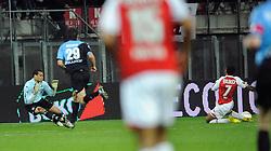 03-04-2010 VOETBAL: AZ - FC UTRECHT: ALKMAAR<br /> FC Utrecht verliest met 2-0 van AZ / Jacob Lenski tikt Moussa Dembele aan en krijgt de rode kaart en een strapschop. Michel Vorm lag goed om de bal te stoppen<br /> ©2010-WWW.FOTOHOOGENDOORN.NL