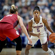 UNCASVILLE, CONNECTICUT- DECEMBER 19:  Crystal Dangerfield #5 of the Connecticut Huskies in action during the Naismith Basketball Hall of Fame Holiday Showcase game between the UConn Huskies Vs Oklahoma Sooners, NCAA Women's Basketball game at the Mohegan Sun Arena, Uncasville, Connecticut. December 19, 2017 (Photo by Tim Clayton/Corbis via Getty Images)