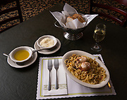 """Linguini Tutto Mare - a seafood broth style sauce with clams, crab meat, shrimp and mushrooms. Photos at Cunetto's House of Pasta """"On The Hill"""" in south St. Louis taken on Wednesday April 21, 2021 for the Better Business Bureau (St. Louis) Torchlight quarterly magazine. <br />Photo byTim Vizer"""