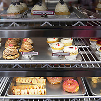 Cupcakes and other pastries sit in display case at I Knead Sugar Friday afternoon at the shop in Gallup. I Knead Sugar was named a Star Business by the Small Business Development Center at UNM-Gallup.