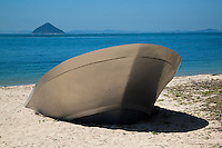 Sunken Boat at Benesse House Beach -Showing public art  in the natural surroundings of Naoshima island has become a popular theme in Japan.  The Benesse House Art Project you can find many examples of works unique to Naoshima scattered around the island.