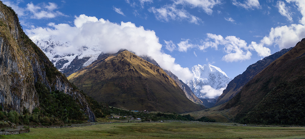 Panoramic view of the village of Soraypampa with Montaña Humantay on the left (in the clouds), and Montaña Salkantay up the valley.