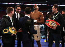 Anthony Joshua post fight with promoter Eddie Hearn (left) following the IBF, WBA and IBO Heavyweight World Title bout against Wladimir Klitschko at Wembley Stadium, London.