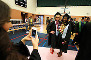 Marina Taylor, left, and Audrena Harlan pose for a photo before Dozier-Libbey Medical High School graduation on Friday, June 8, 2012.  (Photo by Kevin Bartram)