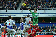 Goalkeeper Robert Green of Queens Park Rangers punches the ball clear.  Barclays Premier league match, Queens Park Rangers v Leicester city at Loftus Road in London on Saturday 29th November 2014.<br /> pic by John Patrick Fletcher, Andrew Orchard sports photography.