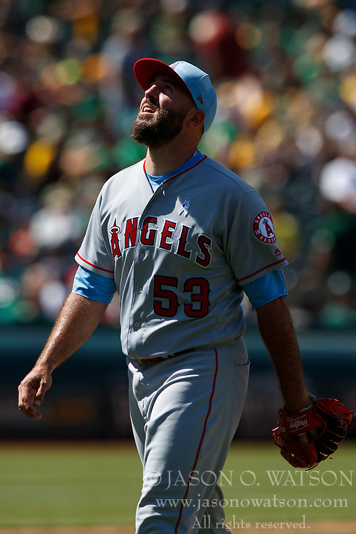 OAKLAND, CA - JUNE 17:  Blake Parker #53 of the Los Angeles Angels of Anaheim returns to the dugout after being relieved during the ninth inning against the Oakland Athletics at the Oakland Coliseum on June 17, 2018 in Oakland, California. The Oakland Athletics defeated the Los Angeles Angels of Anaheim 6-5 in 11 innings. (Photo by Jason O. Watson/Getty Images) *** Local Caption *** Blake Parker