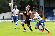 Newport County's Michael Flynn (c) battles for the ball against Bury's Jordan Mustoe. Skybet Football League two match, Bury v Newport county at Gigg Lane in Bury on Saturday 5th Oct 2013. pic by David Richards, Andrew Orchard sports photography,