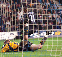 Photo: Paul Greenwood.<br />Wigan Athletic v Chelsea. The Barclays Premiership. 23/12/2006. Wigan Keeper Chris Kirkland saves on the goal line at the feet of Chelsea's Salomon Kalou.