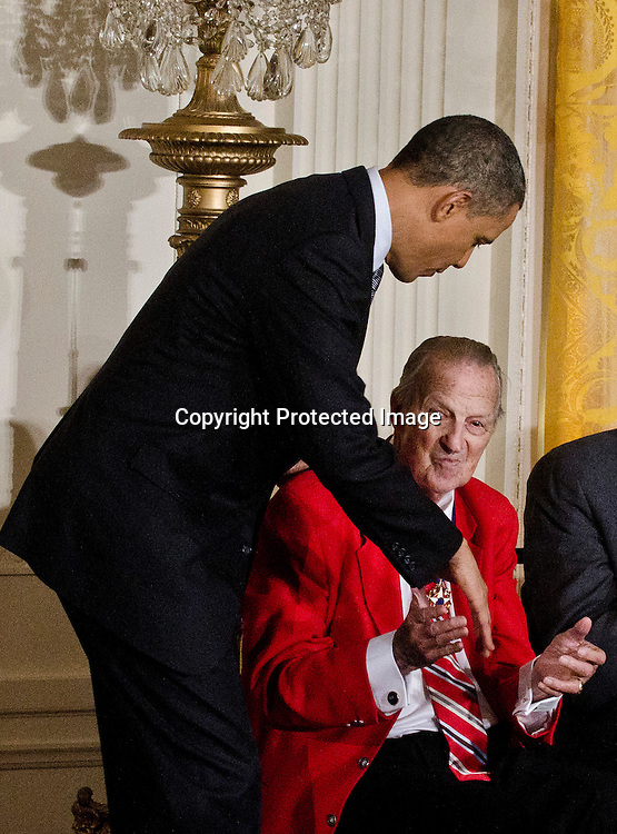 Stan Musial receives the Medal of Freedom medal from President Barack Obama during a ceremony in the East Room of the White House in Washington DC on February 15, 2011. Photo by Kris Connor