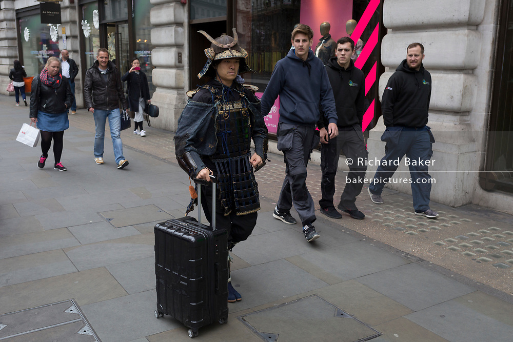 A man dressed in the armor of a medieval Japanese Samurai warrior on 4th May 2017, in London, England.