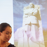 012015  Adron Gardner<br /> <br /> Zunneh-bah Martin, who was the Youth Ambassador representing the Navajo Nation at the White House Tribal Nations Conference in December, is backdropped by a projected photograph of the Martin Luther King Jr. Memorial in Washing D.C. at the Quality Inn in Window Rock Tuesday.