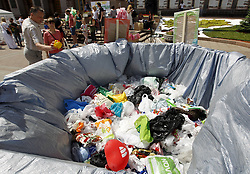 "May 26, 2019 - Kiev, Ukraine - A man throws out a plastic bag in a big trash can installed by activists during a protest against using plastic bags, near the City Hall in Kiev, Ukraine, on 26 May, 2019. Activists demand to support the bill  â""–9507 'On the reduction of the number of individual types of polyethylene waste in civilian circulation', which will impose restrictions on the use of plastic bags in Ukraine. (Credit Image: © Str/NurPhoto via ZUMA Press)"