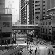 Pedestrians crossing the street near the Prince's Building in Hong Kong. Photo: © Rod Mountain