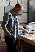 Springfield Missouri artist Jeff Broekhoven painting in his studio.