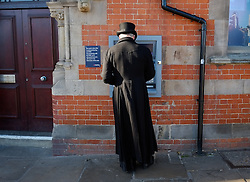 © Licensed to London News Pictures. <br /> 01/11/2014. <br /> <br /> Whitby, Yorkshire, United Kingdom<br /> <br /> A man dressed in Gothic Victoriana withdraws money from a cashpoint during the Whitby Goth Weekend. <br /> <br /> The event this weekend brings together thousands of extravagantly dressed followers of Victoriana, Steampunk, Cybergoth and Romanticism who all visit the town to take part in celebrating Gothic culture. This weekend marks the 20th anniversary since the event was started by local woman Jo Hampshire.<br /> <br /> Photo credit : Ian Forsyth/LNP
