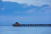 The pier at Naples beach at dusk in Florida, United States of America<br /> FINE ART PHOTOGRAPHY by Tim Graham