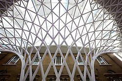 © licensed to London News Pictures. London, UK 19/03/2012. A view of the roof of the new concourse at King's Cross train station in London which opened to commuters today (19/03/2012). Photo credit: Tolga Akmen/LNP