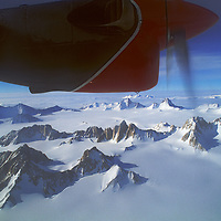 A Twin Otter ski plane flies over the Gothic Mountains in Queen Maud Range of the Transantarctic Mountains (86 deg.S.)